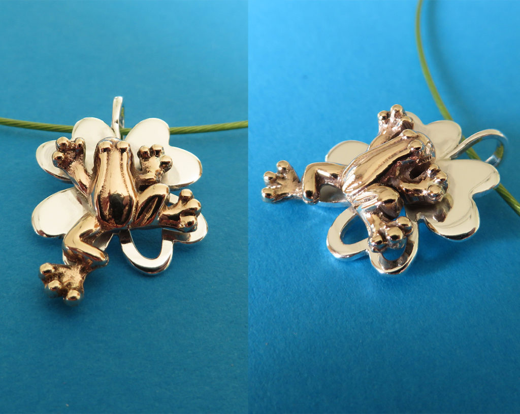 Hanger bronzen kikker op zilveren klavertje 4